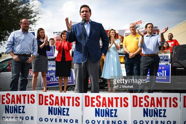 Republican nominee for Governor of Florida Ron DeSantis attends a rally at Freedom Pharmacy on the final day of campaigning in the midterm elections...