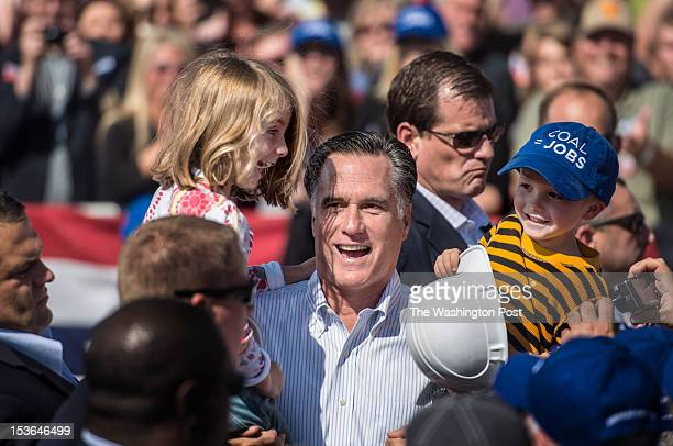 Republican nominee for President Governor Mitt Romney awkwardly picks up two kids during a rally in south western Virginia in Abingdon Virginia on...