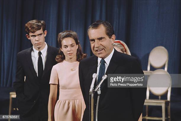 Republican nominee for President of the United States Richard Nixon pictured making a speech with his daughter Julie and her fiance David Eisenhower...