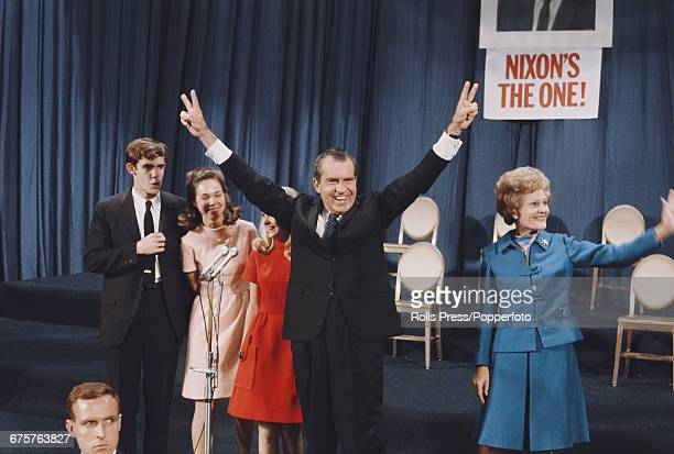 Republican nominee for President of the United States, Richard Nixon pictured with his arms raised in the air in celebration with his wife Pat Nixon...