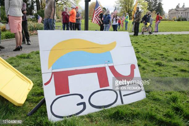 Republican Party elephant logo is pictured with the hair of US President Donald Trump during a demonstration against Washington state's stay-home...