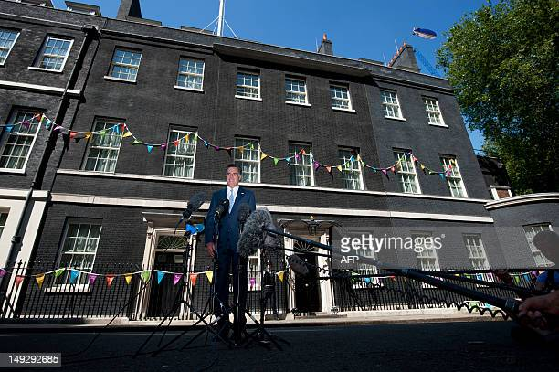 US Republican Party nominee Mitt Romney speaks to the media following a meeting with Britain's Prime Minister David Cameron at 10 Downing street in...