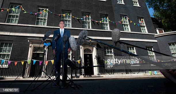 US Republican Party nominee Mitt Romney speaks to the media outside 10 Downing street after a meeting with Britain's Prime Minister David Cameron in...