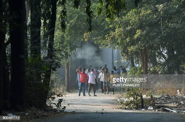 Republican Party of India supporters gesture towards policemen after a protest turned violent in Mumbai on January 2 2018 India's Republican Party...