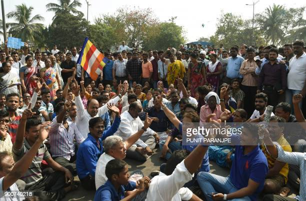 Republican Party of India supporters shout slogans as they block traffic on the Eastern expressway during a protest in Mumbai on January 3 2018...