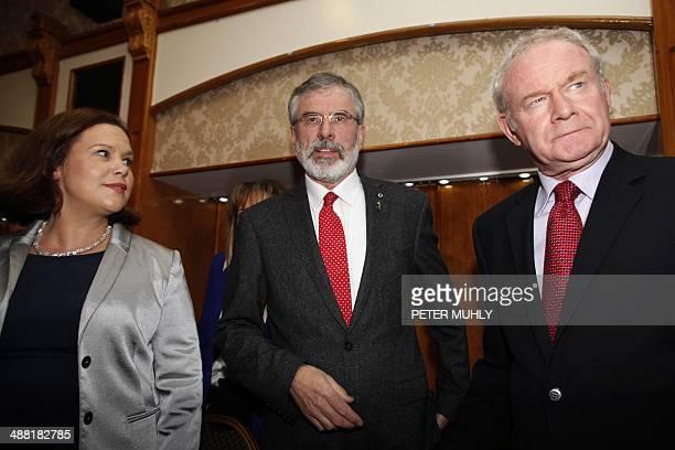 Republican party Sinn Fein leader Gerry Adams stands with Sinn Fein politician and Deputy First Minister of Northern Ireland Martin McGuinness and...