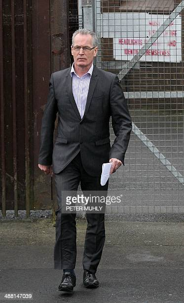 Republican party Sinn Fein's Gerry Kelly walks through the pedestrian exit of Antrim Police station in Antrim Northern Ireland May 4, 2014 to speak...