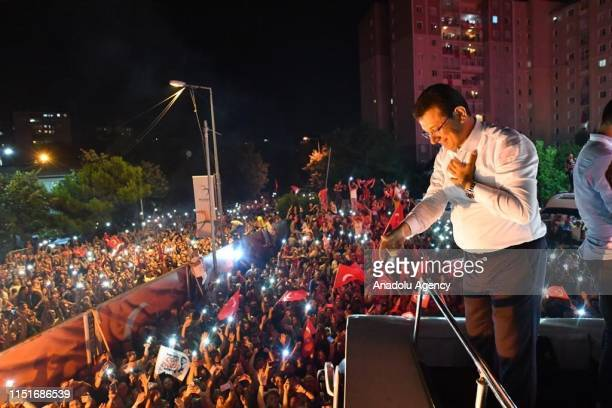 Republican People Party 's mayoral candidate for Istanbul, Ekrem Imamoglu greets the crowd at Beylikduzu Cumhuriyet Square as unofficial results are...