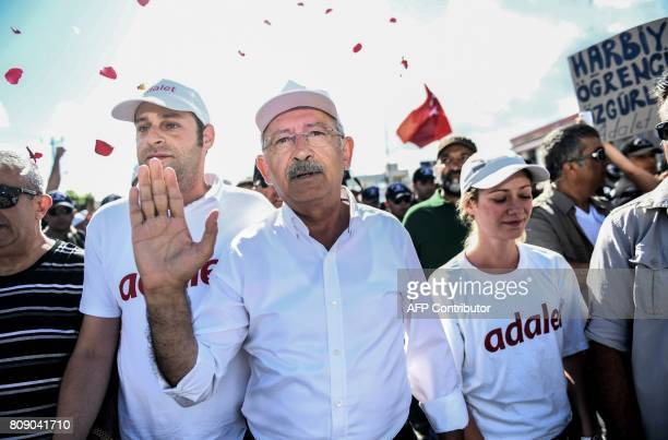 Republican People's Party leader Kemal Kilicdaroglu waves as he walks with thousands of supporters in Izmit on July 5 on the 21st day of a threeweek...