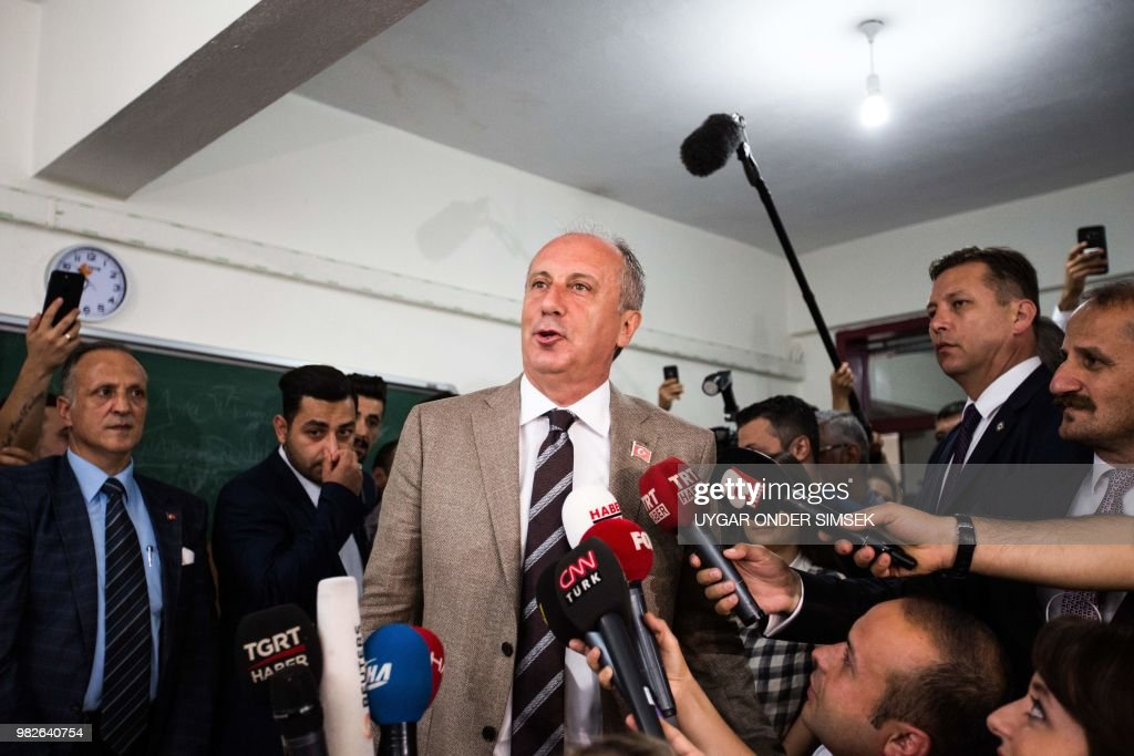 Republican Peoples Party's (CHP) presidential candidate Muharrem Ince speaks to the press at a polling station during the parliamentary and presidential elections, in Yalova on June 24, 2018 - Turks began voting in dual parliamentary and presidential polls seen as the President's toughest election test, with the opposition revitalised and his popularity at risk from growing economic troubles.