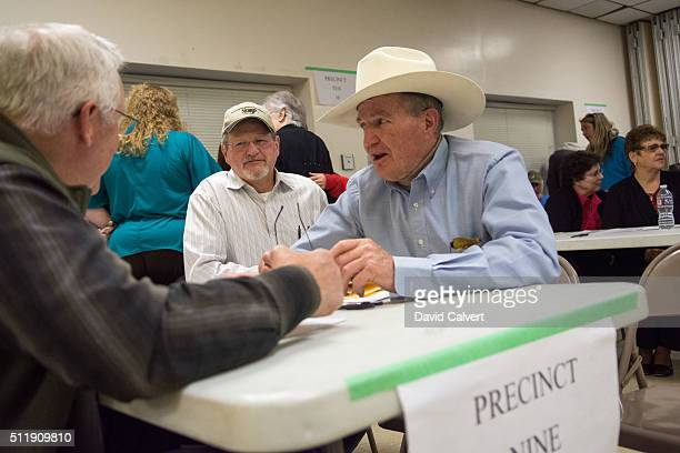 Republican precinct captain Joe Dahl right talks with Tom Riggins center and Ernie Shank left during the caucus at the Churchill County Fairgrounds...