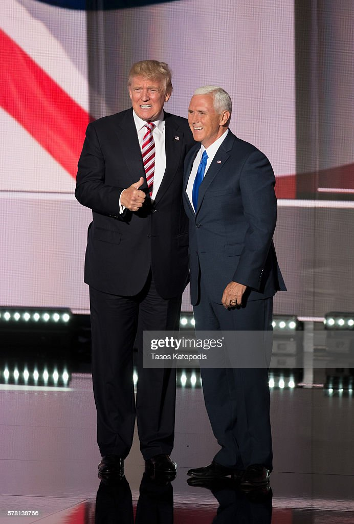 Republican presdential candidate Donald Trump and Indiana Governor MIke Pence take the stage on the third day of the Republican National Convention on July 20 2016 at the Quicken Loans Arena in Cleveland, Ohio. An estimated 50,000 people are expected in Cleveland, including hundreds of protestors and members of the media.