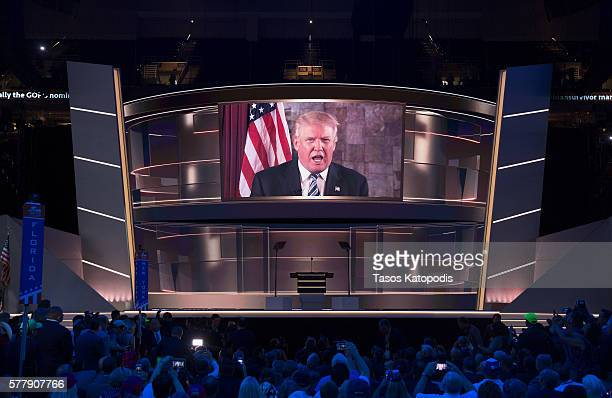 Republican Presedential candidate Donald Trump speaks via video message on the second day of the Republican National Convention on July 19 2016 at...