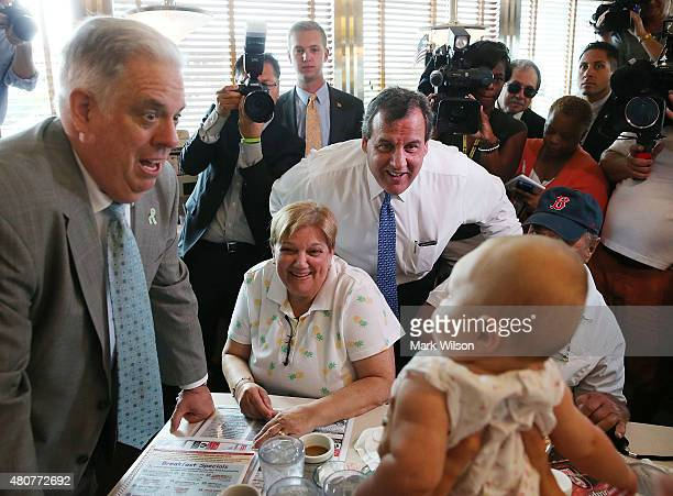 Republican presidentail candidate New Jersey Gov Chris Christie and Maryland Gov Larry Hogan greet patrons during a campaign stop at the Double T...