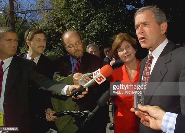 Republican presidental candidate and Texas Governor George W Bush and his wife Laura speak with the media 17 October on his campaign trail and...