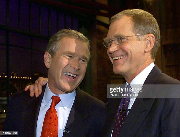 Republican presidental candidate and Texas Governor George W Bush poses for photographers with David Letterman after concluding taping of the 19...