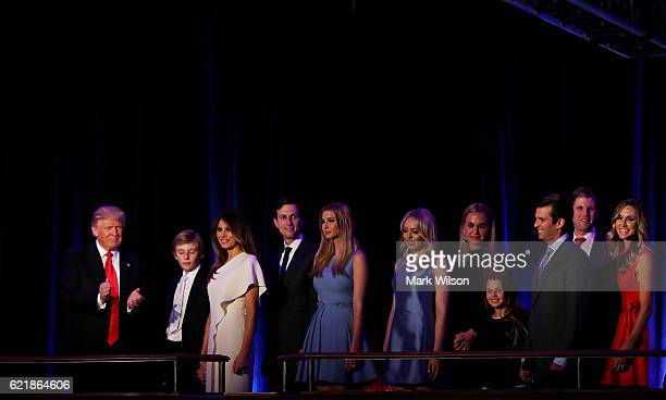 Republican president-elect Donald Trump acknowledges the crowd along with his family during his election night event at the New York Hilton Midtown...