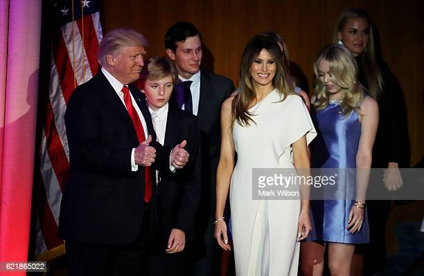 Republican presidentelect Donald Trump acknowledges the crowd along with his son Barron Trump wife Melania Trump Jared Kushner and Tiffany Trump...