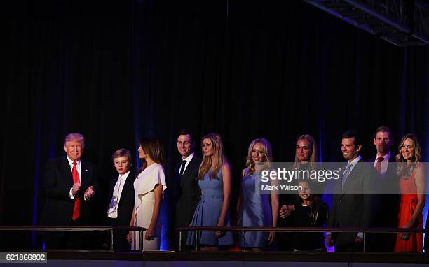 Republican presidentelect Donald Trump acknowledges the crowd along with his son Barron Trump wife Melania Trump Jared Kushner Ivanka Trump Tiffany...