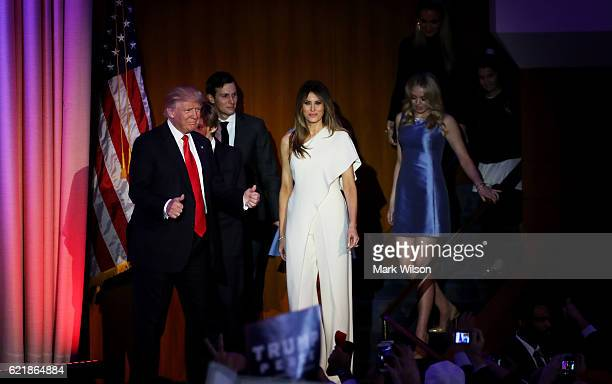 Republican presidentelect Donald Trump acknowledges walks on stage with his son Barron Trump wife Melania Trump Jared Kushner and Tiffany Trump...