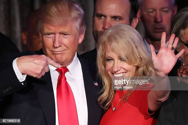Republican presidentelect Donald Trump along with his campaign manager Kellyanne Conway acknowledge the crowd during his election night event at the...