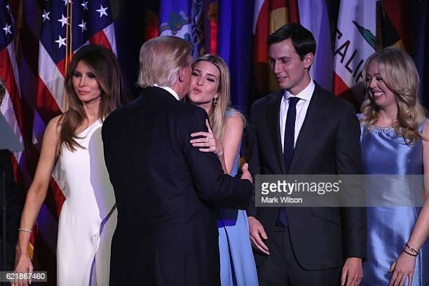 Republican presidentelect Donald Trump and his daughter Ivanka Trump embrace as his wife Melania Trump Jared Kushner ad Tiffany Trump look on after...
