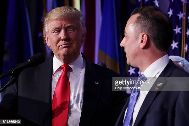 Republican presidentelect Donald Trump and Reince Priebus chairman of the Republican National Committee look on during his election night event at...