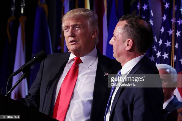 Republican presidentelect Donald Trump and Reince Priebus chairman of the Republican National Committee embrace during his election night event at...