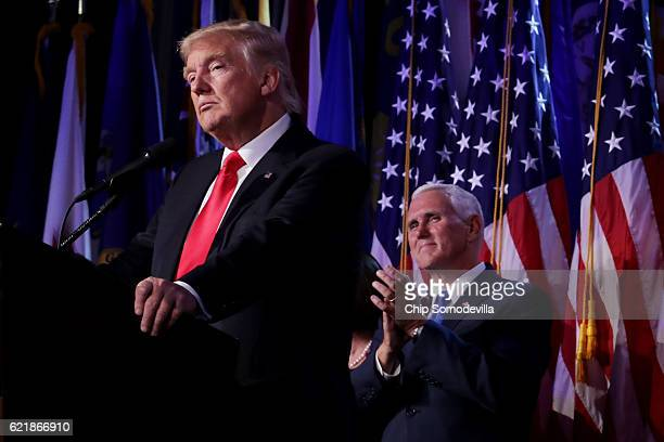 Republican presidentelect Donald Trump delivers his acceptance speech as Vice presidentelect Mike Pence looks on during his election night event at...