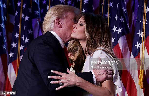 Republican presidentelect Donald Trump embraces his wife Melania Trump during his election night event at the New York Hilton Midtown in the early...