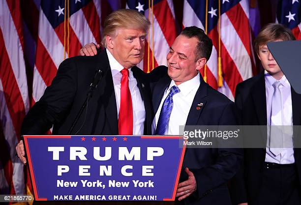 Republican presidentelect Donald Trump embraces Reince Priebus chairman of the Republican National Committee during his election night event at the...