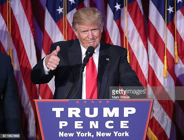 Republican president-elect Donald Trump gives a thumbs up to the crowd during his acceptance speech at his election night event at the New York...