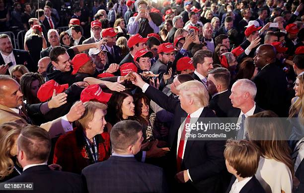 Republican presidentelect Donald Trump gives greets people in the crowd after delivering his acceptance speech at the New York Hilton Midtown in the...