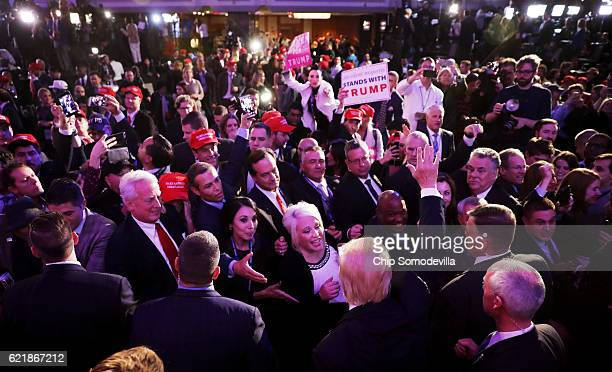 Republican presidentelect Donald Trump greets people in the crowd after delivering his acceptance speech at the New York Hilton Midtown in the early...