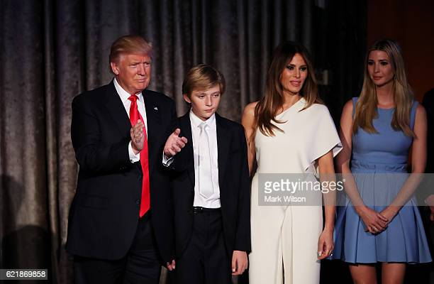 Republican presidentelect Donald Trump his son Barron Trump wife Melania Trump and daughter Ivanka Trump acknowledges the crowd along with his son...