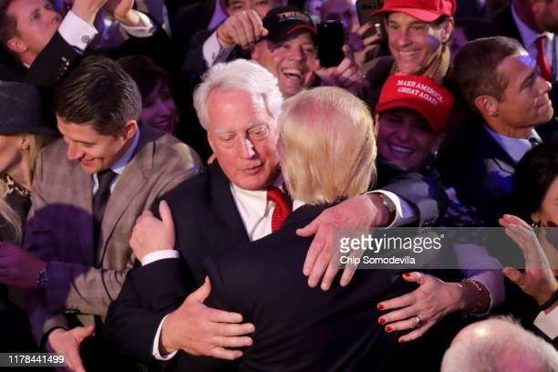 Republican president-elect Donald Trump hugs his brother Robert Trump after delivering his acceptance speech at the New York Hilton Midtown in the...