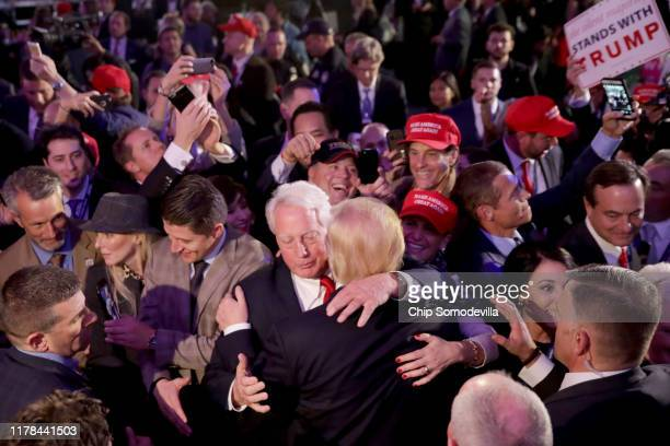 Republican presidentelect Donald Trump hugs his brother Robert Trump after delivering his acceptance speech at the New York Hilton Midtown in the...