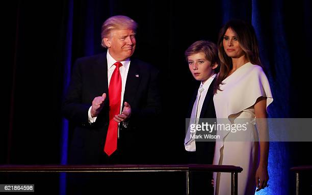 Republican presidentelect Donald Trump walks on stage with his son Barron Trump and wife Melania Trump during his election night event at the New...