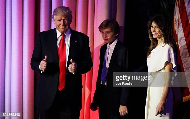 Republican presidentelect Donald Trump walks on stage with his son Barron Trump wife Melania Trump during his election night event at the New York...