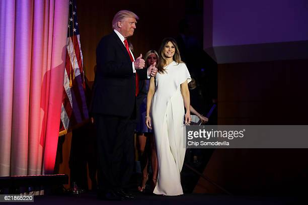 Republican presidentelect Donald Trump walks on stage with his wife Melania Trump during his election night event at the New York Hilton Midtown in...