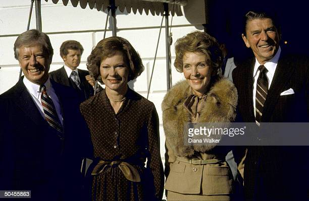 Republican Presidentelect Ronald Reagan and wife Nancy standing with President Jimmy Carter wife Rosalynn outside the White House