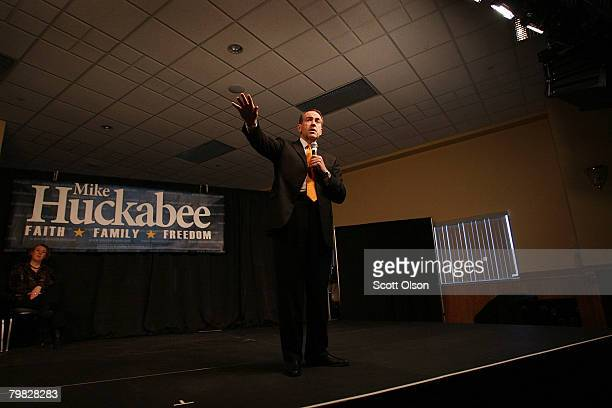 Republican presidential candidate and former Arkansas Gov. Mike Huckabee campaigns at the Wave Ballroom while his wife Janet watches February 18,...