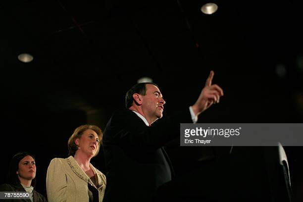 Republican presidential candidate and former Arkansas Gov. Mike Huckabee speaks to supporters as his wife Janet and their daughter Sarah look on...