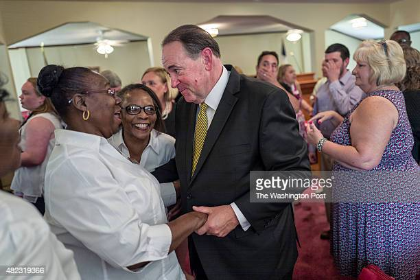 Republican presidential candidate and former Arkansas Governor Mike Huckabee attends the Faith and Freedom Sunday service at the Rock Hill Missionary...
