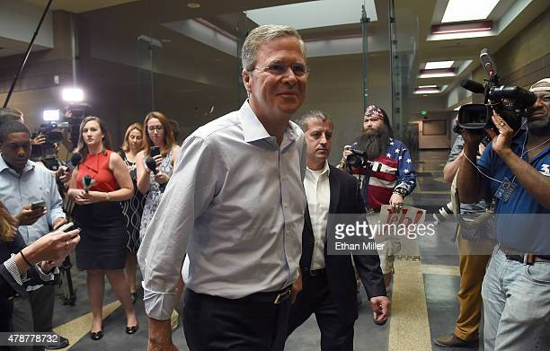 Republican presidential candidate and former Florida Gov Jeb Bush smiles after speaking with members of the media following a town hall meeting at...