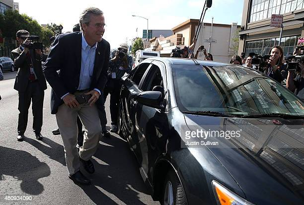 Republican presidential candidate and former Florida governor Jeb Bush gets out of an Uber car as he arrives at Thumbtack on July 16, 2015 in San...