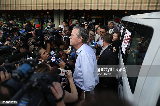 Republican presidential candidate and former Florida Governor Jeb Bush speaks with the media as he holds a meet and greet at Chico's Restaurant on...