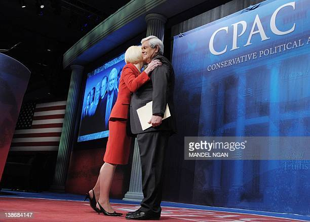Republican presidential candidate and former House Speaker Newt Gingrich receives a hug from his wife Callista after she introduced him speaks at the...