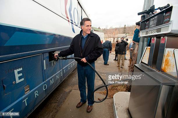 Republican presidential candidate and former MA Governor Mitt Romney pumping diesel into his campaign bus at Lowe's Store in Randolph NH during a a...