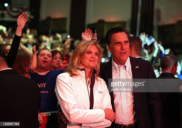 Republican presidential candidate and former Massachusetts Gov Mitt Romney and his wife Ann Romney look on as musician Kid Rock performs during a...
